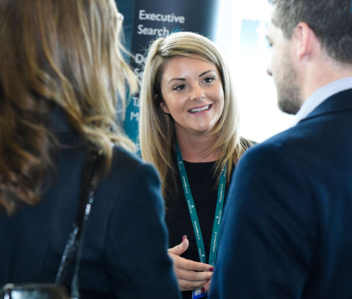 Jonathan Lee Recruitment's Teresa talking with delegates at an event