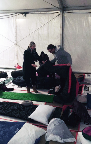 A man unfolding his sleeping bag at the Centrepoint Sleep Out