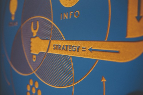 Blue background with the word strategy embossed on it.