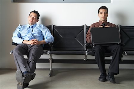 2 men waiting for job interview