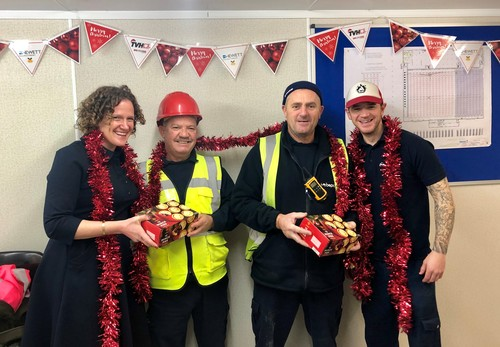 Laura Hewett with TVH Staff at the Stourport Road site sharing some Christmas spirit in the shape of decorations and mince pies!