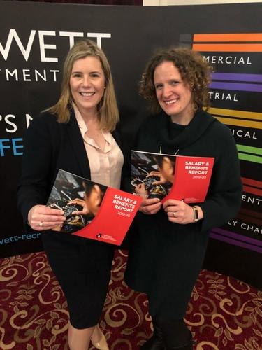 Cassie Bray & Laura Hewett holding 2019 2020 Salary & Benefits report Hewett Recruitment and Herefordshire & Worcestershire Chamber of Commerce.