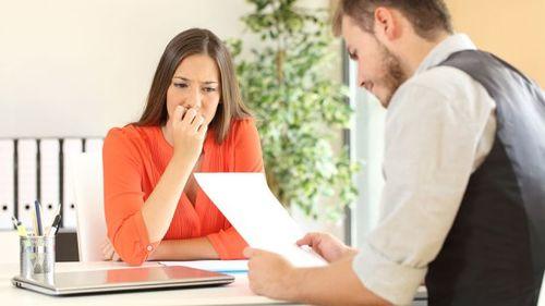 woman looking nervous in job interview