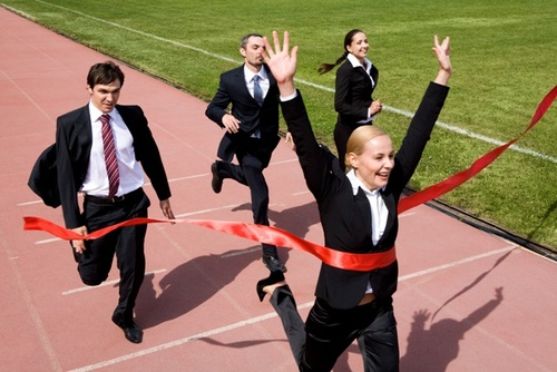 young professionals running in suits