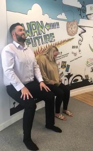 Swanstaff team completing wallsits for WOW week