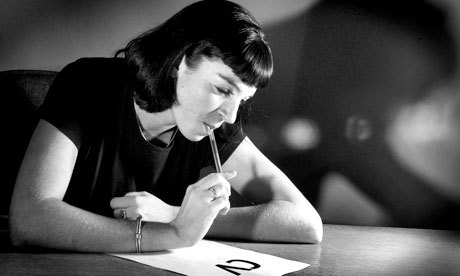 Woman writing up her CV - CV writing - Resume Writing - woman in black and white
