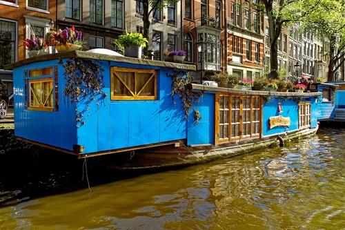 Woonboot in de grachten - werken in Nederland