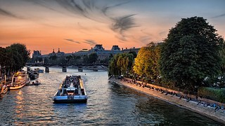 Seine River in Paris - Boat in Sunset Paris France