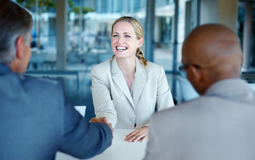 blonde woman smiling in job interview
